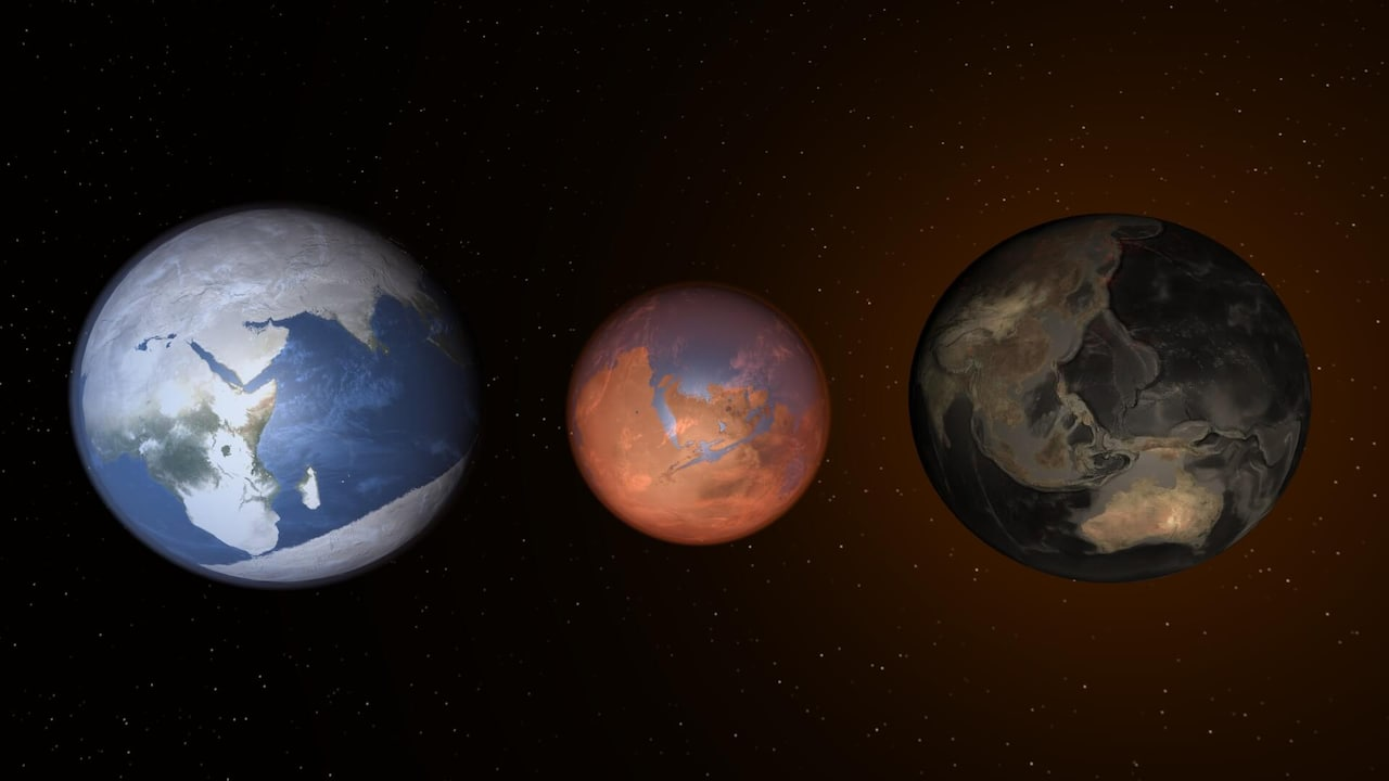 Earth is completely frozen over next to a terraformed Mars, which is next to an Earth with no water.